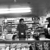 I work at a gas station. This is me standing at the counter during a graveyard shift when there was nobody inside. This picture is black and white because nobody would want to work a graveyard shift at a gas station and I thought that making it black and white would tell the story. If this picture is colorful it would probably mean something else but since its black and white it's a sad image. It's me at 12am, alone, doing nothing, kind of scary, but nothing happened that day. I'm in college now and when I think about me working after ten years, you know, when I look at myself, I don't see myself as something very specific but I have a dream inside me and everyday when I wake up I think about that dream. (Photograph by Birendra Dikhal)