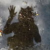 This picture is a self portrait. It reminds me of the rainy season in Mae La camp. (Photograph by Maria Mu)