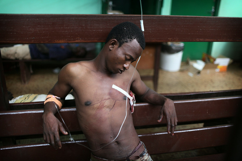 A wounded man wait for treatment at the community hospital in Bangui, Central African Republic. © Pierre Terdjman, Exhibition: Paris Match