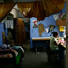 A woman sewing in a workshop set up inside her apartment. © Jorge Silva / Reuters