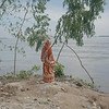 """Kurigram District, Bangladesh, 2012. <br /> Severe flooding hit more than 400 000 people in Kurigram district.  Khushi, who is camping by the dam with her family, can only reflect on the loss while the flood takes its toll. From the series """"Life on Water – Bangladesh Floods.""""<br /> """"This award gave me great exposure in the photography world"""" © Rasel Chowdhury, Ian Parry Scholarship Winner 2011"""