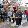 Young men hold up wooden platforms with statues of Jesus Christ during the noon Good Friday procession at the El Santuario de Chimayó commemorating the crucifixion of Jesus Christ and his death at Calvary. During the rest of the year these statues of Jesus are on display at the El Santuario de Chimayo. (Photo by Hélène Casanova)