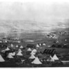 1855 - View of encampment showing bell tents, huts, soldiers, and horses. View looking towards Kadikoi. (Roger Fenton Crimean War photograph collection, Library of Congress Prints and Photographs Division)