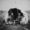 1855 - Colonel Brownrigg, ull-length portrait, seated, facing right; and two captured Russian boys, one standing and one sitting, at entrance to tent. (Roger Fenton Crimean War photograph collection, Library of Congress Prints and Photographs Division)