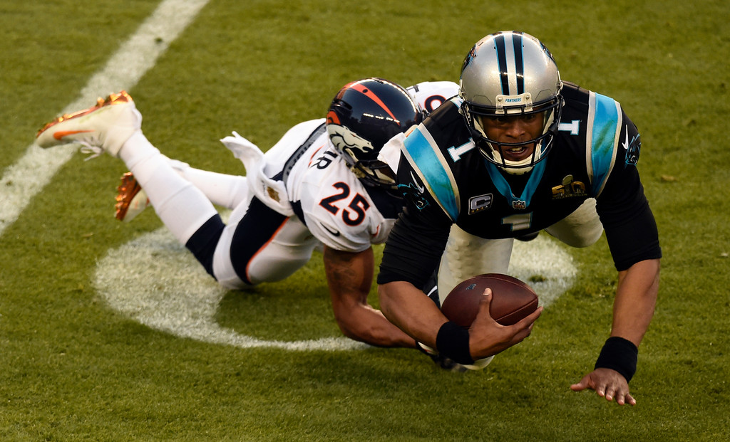 . Cam Newton (1) of the Carolina Panthers gets taken down by Chris Harris (25) of the Denver Broncos in the second quarter.  The Denver Broncos played the Carolina Panthers in Super Bowl 50 at Levi\'s Stadium in Santa Clara, Calif. on February 7, 2016. (Photo by John Leyba/The Denver Post)
