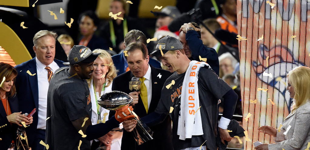 . SANTA CLARA, CA - FEBRUARY 7: MVP Von Miller (58) of the Denver Broncos hands the Vince Lombardi Trophy to Peyton Manning (18) of the Denver Broncos after the game.  The Broncos defeated the Panthers 24 to 10 in Super Bowl 50.  The Denver Broncos played the Carolina Panthers in Super Bowl 50 at Levi\'s Stadium in Santa Clara, Calif. on February 7, 2016. (Photo by John Leyba/The Denver Post)
