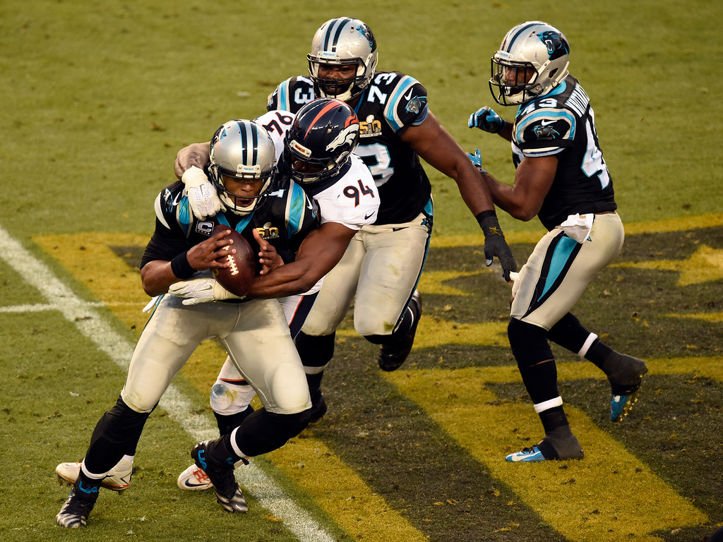 . Cam Newton (1) of the Carolina Panthers gets sacked by DeMarcus Ware (94) of the Denver Broncos in the second quarter.  The Denver Broncos played the Carolina Panthers in Super Bowl 50 at Levi\'s Stadium in Santa Clara, Calif. on February 7, 2016. (Photo by John Leyba/The Denver Post)