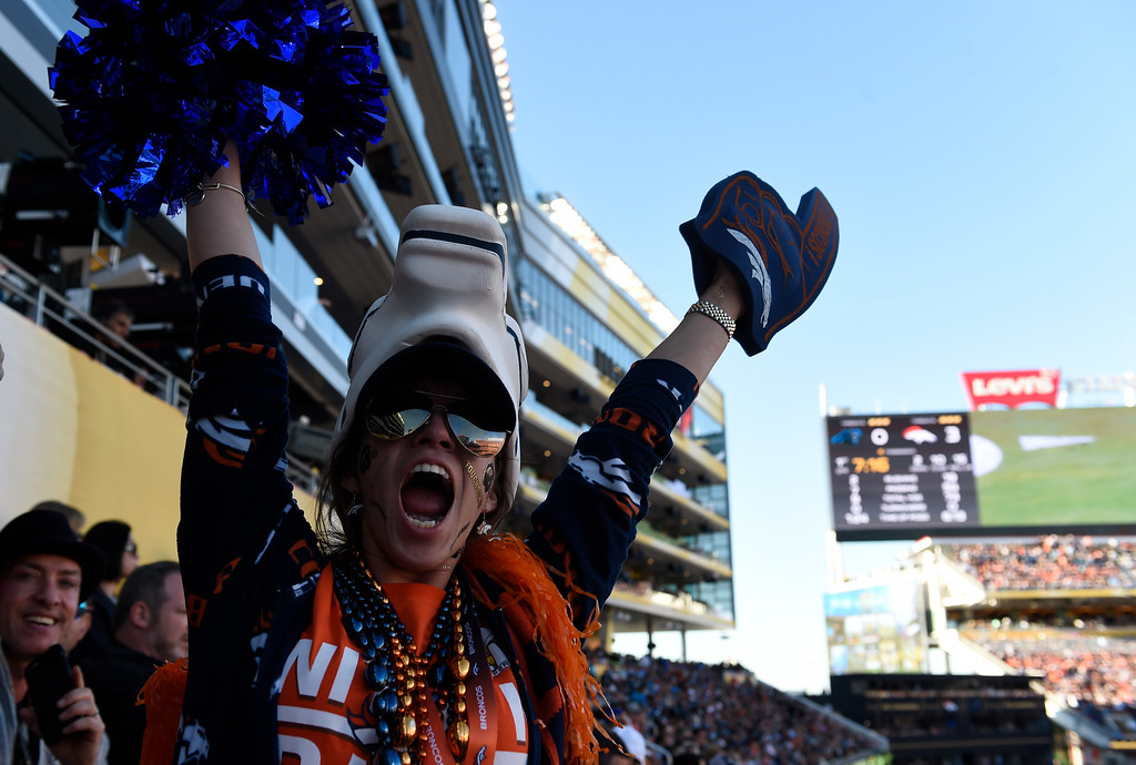 . Broncos fan Iara Cucina of Fort Collins, CO cheers on the team. The Denver Broncos played the Carolina Panthers in Super Bowl 50 at Levi\'s Stadium in Santa Clara, Calif. on February 7, 2016. (Photo by RJ Sangosti/The Denver Post)
