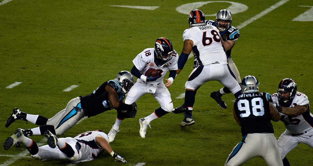 . Peyton Manning (18) of the Denver Broncos gets sacked by Kony Ealy (94) of the Carolina Panthers in the third quarter. The Denver Broncos played the Carolina Panthers in Super Bowl 50 at Levi\'s Stadium in Santa Clara, Calif. on February 7, 2016. (Photo by John Leyba/The Denver Post)