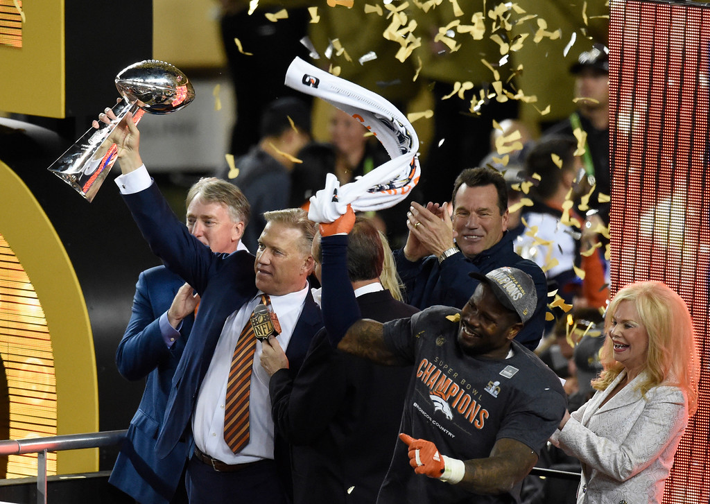 . SANTA CLARA, CA - FEBRUARY 7: Executive Vice President of Football Operations/General Manager John Elway holds up the Vince Lombardi Trophy while Von Miller (58) celebrates with head coach Gary Kubiak, President and CEO Joe Ellis, and Annabel Bowlen.  The Broncos defeated the Panthers 24 to 10 in Super Bowl 50.  The Denver Broncos played the Carolina Panthers in Super Bowl 50 at Levi\'s Stadium in Santa Clara, Calif. on February 7, 2016. (Photo by John Leyba/The Denver Post)