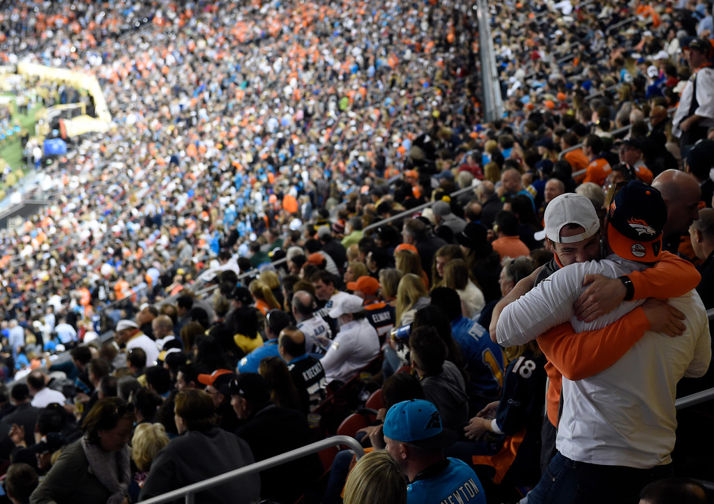 . Broncos fans embrace near the end of the game.  The Broncos defeated the Panthers 24 to 10 in Super Bowl 50. The Denver Broncos played the Carolina Panthers in Super Bowl 50 at Levi\'s Stadium in Santa Clara, Calif. on February 7, 2016. (Photo by RJ Sangosti/The Denver Post)