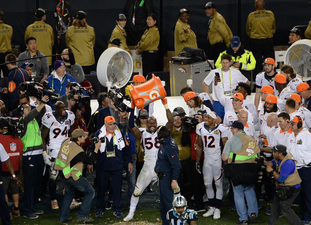 . Von Miller (58) of the Denver Broncos holds up the cooler in triumph after he dumped Gatorade on head coach Gary Kubiak of the Denver Broncos as the Broncos win the Super Bowl. The Broncos defeated the Panthers 24 to 10 in Super Bowl 50. The Denver Broncos played the Carolina Panthers in Super Bowl 50 at Levi\'s Stadium in Santa Clara, Calif. on February 7, 2016. (Photo by RJ Sangosti/The Denver Post)