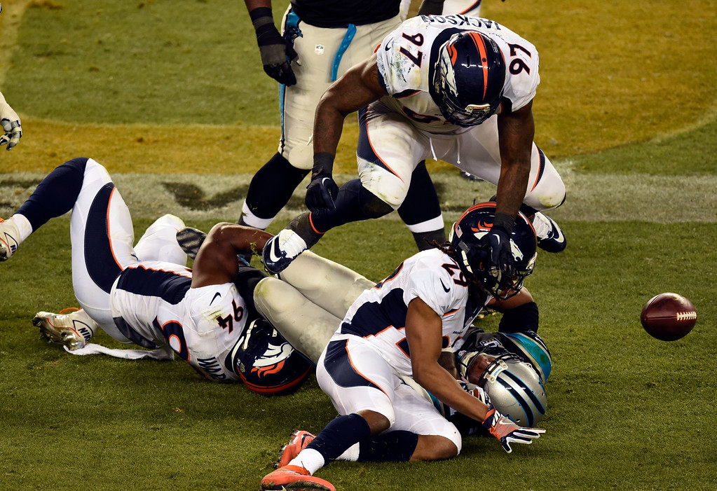 . The ball pops loose as Cam Newton (1) of the Carolina Panthers gets sacked in the third quarter.  The Denver Broncos played the Carolina Panthers in Super Bowl 50 at Levi\'s Stadium in Santa Clara, Calif. on February 7, 2016. (Photo by John Leyba/The Denver Post)