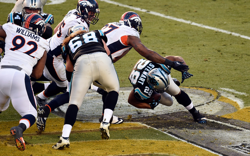 . Jonathan Stewart (28) of the Carolina Panthers gets tripped up in the first quarter.  The Denver Broncos played the Carolina Panthers in Super Bowl 50 at Levi\'s Stadium in Santa Clara, Calif. on February 7, 2016. (Photo by John Leyba/The Denver Post)