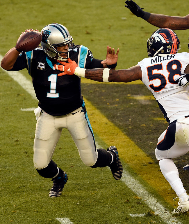 . Cam Newton (1) of the Carolina Panthers gets pressured by Von Miller (58) of the Denver Broncos in the second quarter.  The Denver Broncos played the Carolina Panthers in Super Bowl 50 at Levi\'s Stadium in Santa Clara, Calif. on February 7, 2016. (Photo by John Leyba/The Denver Post)