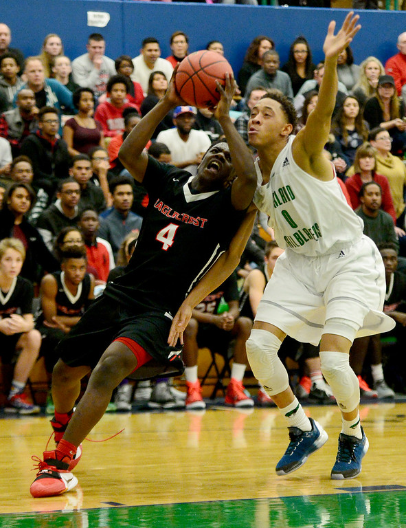 . Xaiv�ion Jackson (4) of EagleCrest  drives on Jervae Robinson (0) of Overland during the second half of EagleCrest\'s 57-45 win. The Overland Trailblazers hosted the Eaglecrest Raptors on Friday, January 8, 2016. (Photo by AAron Ontiveroz/The Denver Post)
