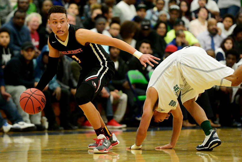 . Colbey Ross (1) of EagleCrest breaks Tyler Stevenson (25) of Overland during the second half of EagleCrest\'s 57-45 win. The Overland Trailblazers hosted the Eaglecrest Raptors on Friday, January 8, 2016. (Photo by AAron Ontiveroz/The Denver Post)
