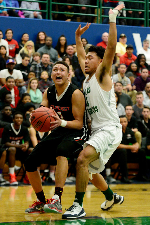 . Colbey Ross (1) of EagleCrest  drives on Tyler Stevenson (25) of Overland during the second half of EagleCrest\'s 57-45 win. The Overland Trailblazers hosted the Eaglecrest Raptors on Friday, January 8, 2016. (Photo by AAron Ontiveroz/The Denver Post)