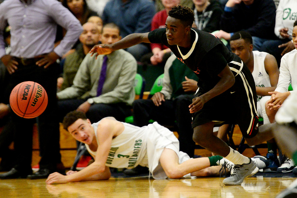 . Kenny Thrower (10) of EagleCrest runs after a loose ball as Brian Price (3) of Overland lies on the floor during the first half of play. The Overland Trailblazers hosted the Eaglecrest Raptors on Friday, January 8, 2016. (Photo by AAron Ontiveroz/The Denver Post)