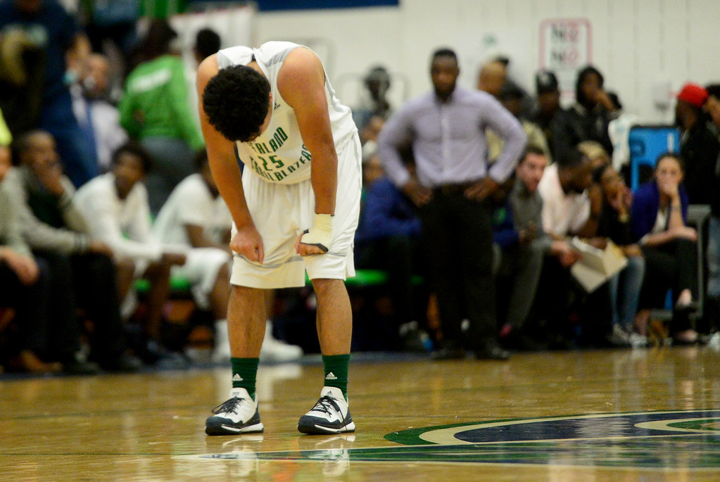 . Tyler Stevenson (25) of Overland hangs his head late during the second half of EagleCrest\'s 57-45 win. The Overland Trailblazers hosted the Eaglecrest Raptors on Friday, January 8, 2016. (Photo by AAron Ontiveroz/The Denver Post)