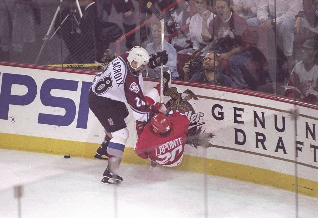 . 15 May 1997: Left wing Eric LaCroix of the Colorado Avalanche checks right wing Martin LaPointe of the Detroit Red Wings during a playoff game at the McNichols Sports Arena in Denver, Colorado. The Avalanche won the game 2-1. Photo by Brian Bahr/Getty Images