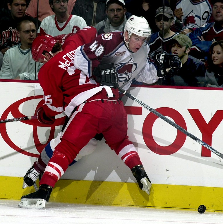 . DENVER, CO Colorado Avalanche Alex Tanguay gets held up against the boards by Red Wings Darren McCarty during the 1st period. The Avalanche led after 2 periods 2-0.  (Photo By John Leyba/The Denver Post)