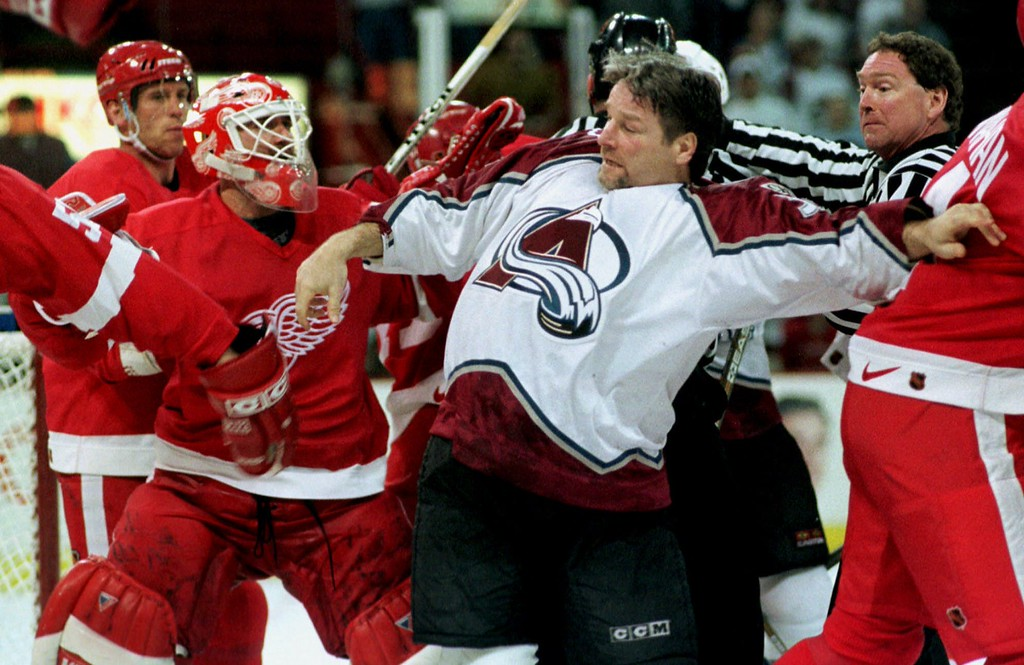 . Detroit Red Wings goalie Bill Ranford, left, squares off against Colorado Avalanche center Dale Hunter after he flipped Ranford next to the net late in the third period of the Red Wings\' 4-0 victory in Game 2 of the teams\' NHL second-round playoff series  in Denver\'s McNichols Sports Arena Sunday, May 9, 1999. The Red Wings took a 2-0 lead in the series as it heads back to the Motor City. (AP Photo/David Zalubowski)