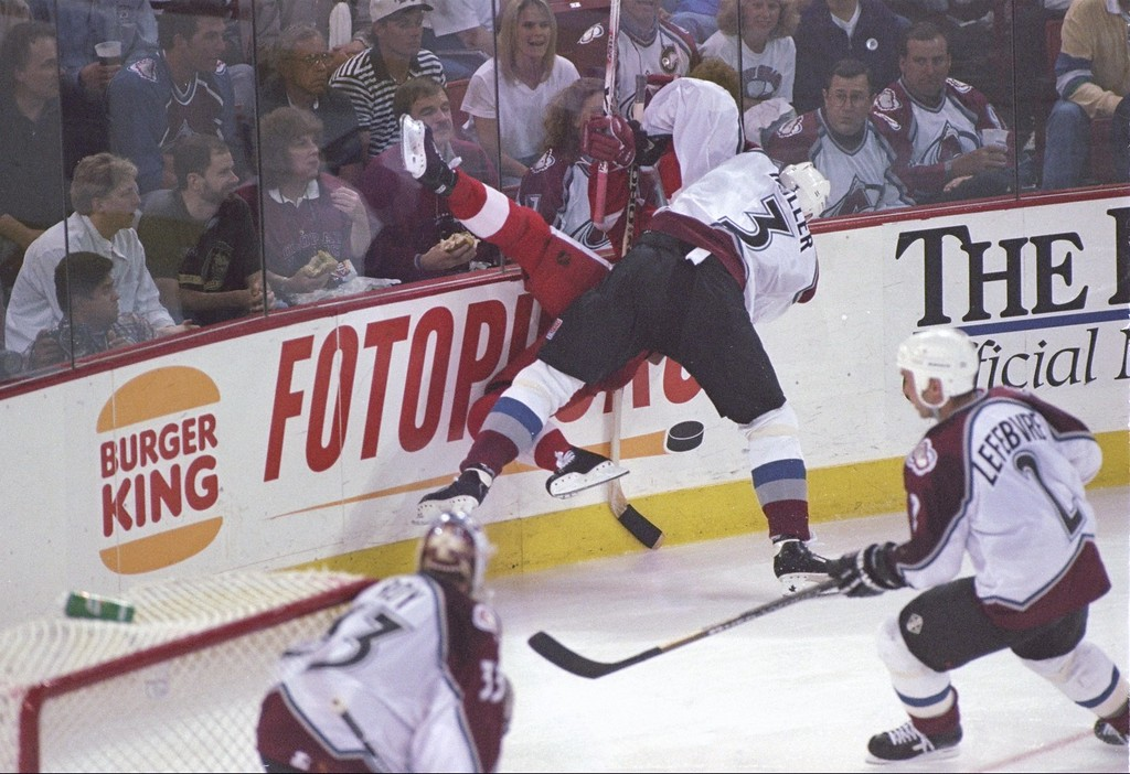 . 15 May 1997:  Defenseman Aaron Miller of the Colorado Avalanche lays a vicious check during a playoff game against the Detroit Red wings at the McNichols Arena in Denver, Colorado.  The Avalanche won the game 2-1. Mandatory Credit: Brian Bahr  /Allsport
