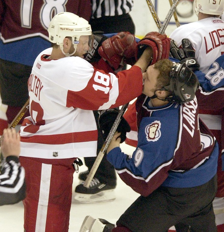 . Tempers flare in the final second as Colorado Avalanche Brad larsen and Detroit Red Wings Kirk Maltby mix it up in game 1 of the Western Confrence Finals at Joe Luis Arena. The Red Wings beat the Avalanche 5-2 to take a one game to none lead in the best of seven. (Photo by JOHN LEYBA/ The Denver Post)