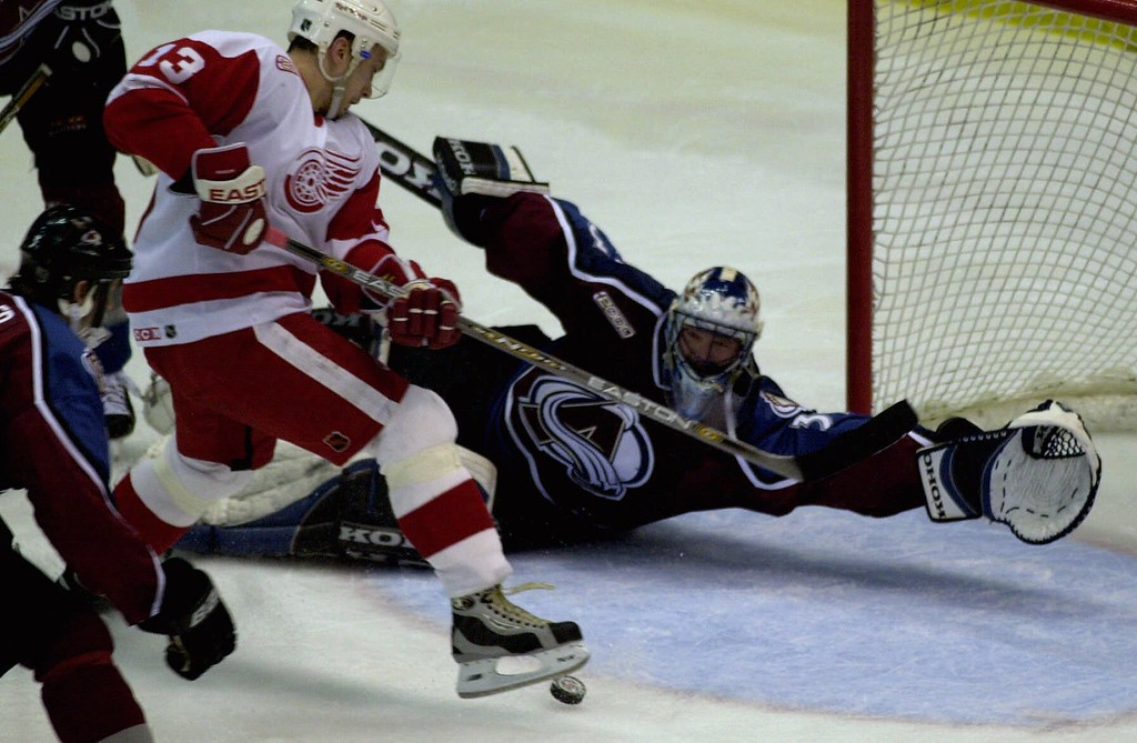 . Colorado Avalanche goalie Patrick Roy prepares to stop Detroit Red Wings winger Vyacheslav Kozlov\'s shot on goal in the overtime period in their Western Conference semis in Detroit, Wednesday, May 3, 2000. Colorado defeated Detroit 3-2 in overtime to take a 3-1 lead in their semifinal series.  (AP Photo/Paul Sancya)