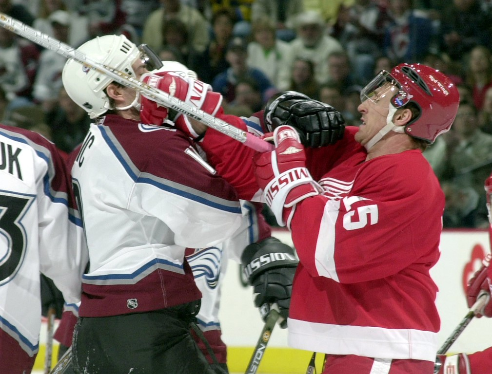 . Detroit Red Wings #15 Pat Verbeek punches Colorado Avalanche Joe Sakic in the face during the first period at Pepsi Center. THE DENVER POST/JOHN LEYBA 2001