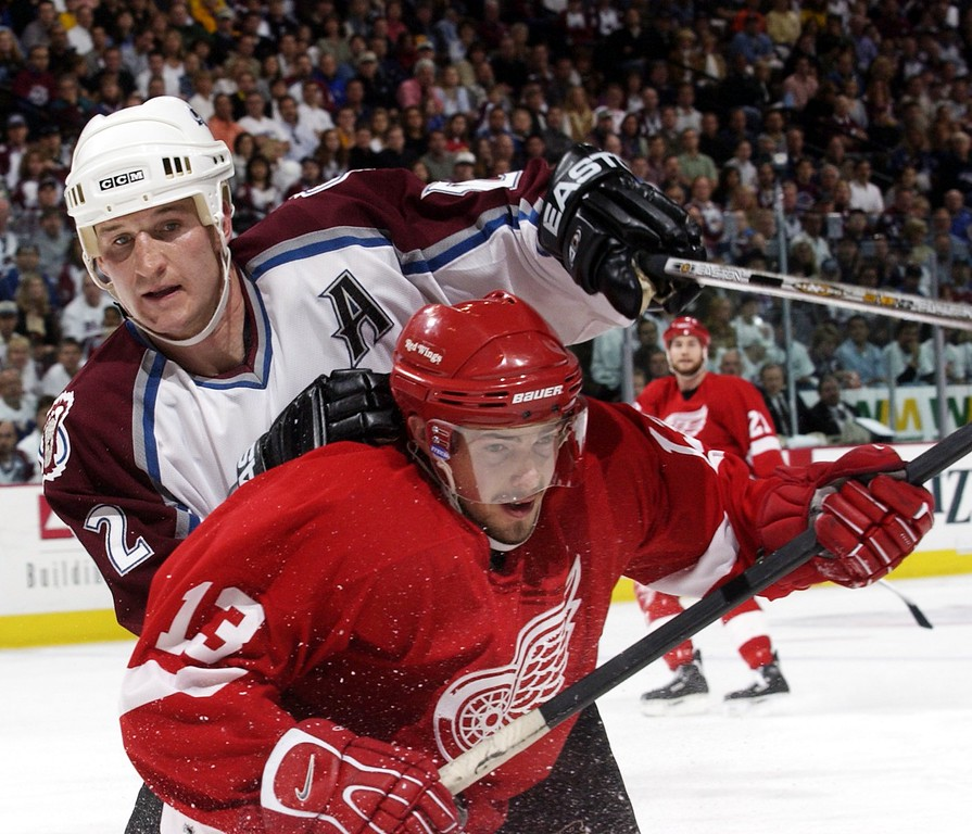 . Colorado Avalanche #52 Adam Foote battles with Red Wings #13 Pavel Datsyuk along the borads during the second period in game 4 of the Western Confrence Finals at Pepsi Center. (Photo by JOHN LEYBA/ The Denver Post)