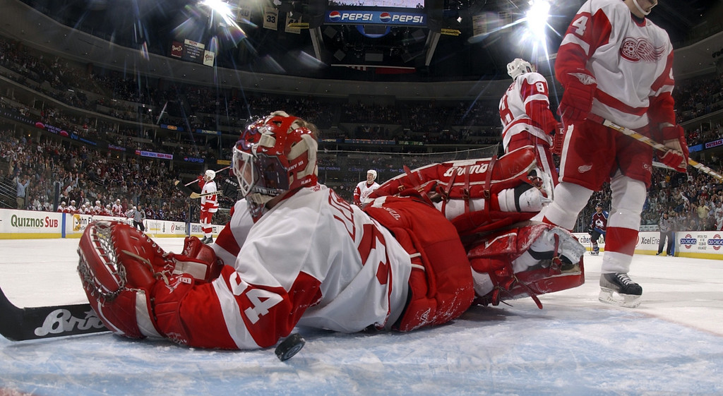 . Red Wing goalie #34 Manny Legace sprawls on the ice after Colorado Avalanche #22 Steve Konowalchuk scores late in the 3rd period of the game between the Colorado Avalanche and the Detroit Red Wings on Thursday March 25th, 2004 at the Pepsi Center in Denver,Co.  The Red Wings won 3-1.                 DENVER POST PHOTO BY STEVE DYKES