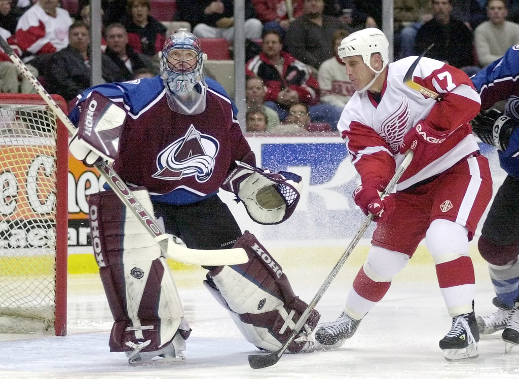 . Colorado Avalanche goalie Patrick Roy (33) deflects a shot from Detroit Red Wings winger Brett Hull (17) during the third period in Detroit, Thursday, Feb. 6, 2003.  Roy recorded his 64th career shutout, tying him with Ed Belfour of Toronto for the most by any active goaltender, in Colorado\'s 1-0 victory Thursday night over Detroit.   (AP Photo/Paul Warner)