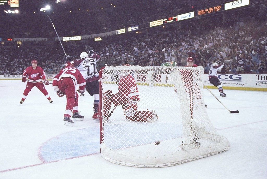 . 24 May 1997: Right wing Claude Lemieux of the Colorado Avalanche shoots the puck at goaltender Chris Osgood of the Detroit Red Wings during a playoff game at the McNichols Sports Arena in Denver, Colorado. The Avalanche won the game 6-0. Photo by Brian Bahr