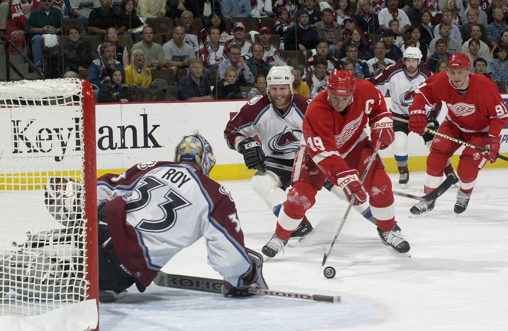 . DENVER - MAY 29: Steve Yzerman #19 of the Detroit Red Wings tries to slip one past Patrick Roy #33 of the Colorado Avalanche in the first period during game six of the Western Conference Finals at the Pepsi Center in Denver, Colorado  on May 29, 2002.  (Photo by Elsa/Getty Images/NHLI)