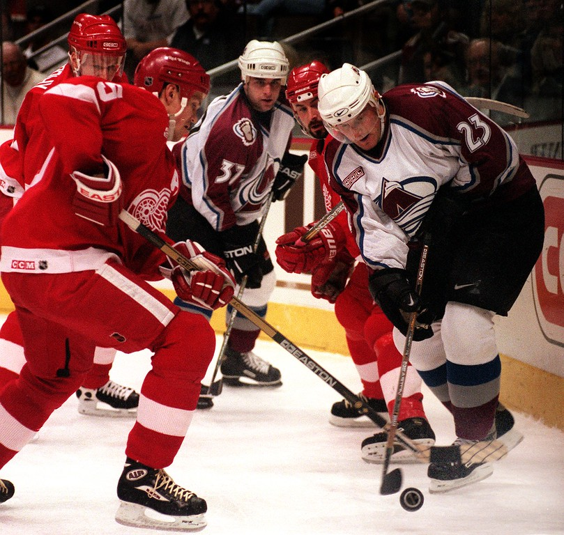 . Avalanche winger Milan Hejduk, right, tried to work his way around the back of Detroit\'s net in the first period. Red Wings defenders Lary Murphy, and Niklas Lidstrom applied the pressure.  (Photo By Karl Gehring/The Denver Post)