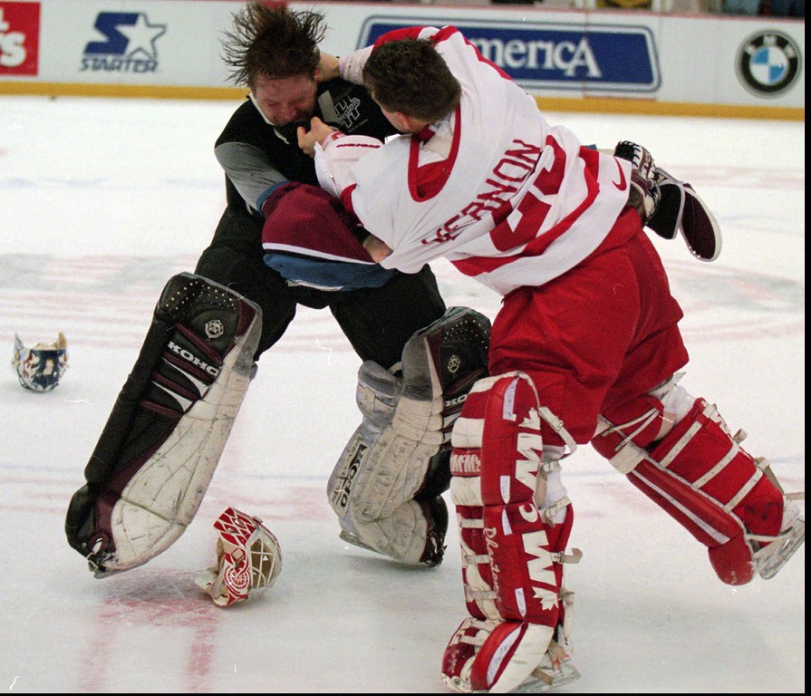 . Colorado Avalanche goaltender Patrick Roy, left, takes a punch from Detroit Red Wings\' goaltender Mike Vernon during a first period brawl in Detroit on Wednesday, March 26, 1997.(AP Photo/Tom Pidgeon)