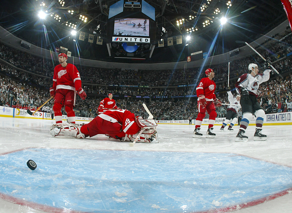 . DENVER - MAY 25:  Joe Sakic #19 of the Colorado Avalanche celebrates his wrist-shot goal from the slot on Dominik Hasek #39 of the Detroit Red Wings in the third period of game four of the Western Conference Finals during the NHL Stanley Cup Playoffs at the Pepsi Center in Denver, Colorado on May 25, 2002. Colorado defeated Detroit 3-2 to tie the series 2-2.  (Photo by Jeff Vinnick/Getty Images/NHLI)