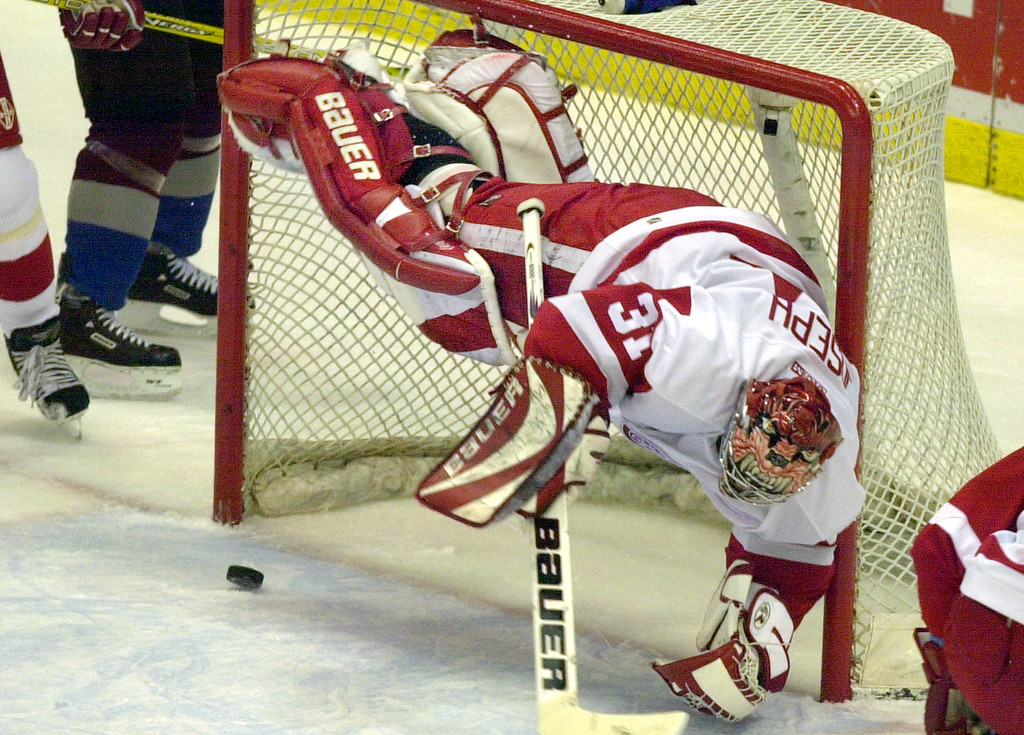 . Detroit Red Wings goalie Curtis Joseph goes airbourne and is beaten on a goal by Colorado Avalanche winger Alex Tanguay during the first period in Detroit, Thursday, Feb. 6, 2003. (AP Photo/Carlos Osorio)