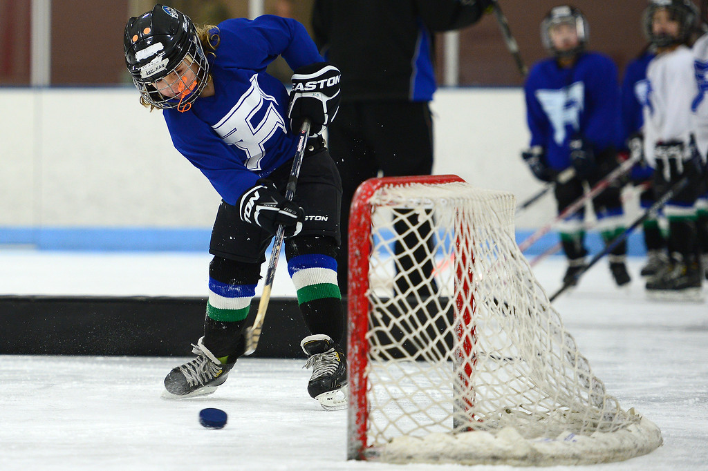 . Kennan Butzen, 8, takes an easy shot on an open net during practice at Edge Ice Arena on February 17, 2016 in Littleton, Colorado. Hockey has developed a following in Colorado especially after the Colorado Avalanche moved into the state 20 years ago. The interest in hockey has begun to boom from three-year-olds to adults, either playing in recreation leagues or learning the game for the first time. The Foothill Flyers are one of those organizations seeing some of that trend with enrollment in their Under 8 league going from 50 children to 100 in three years. (Photo by Brent Lewis/The Denver Post)