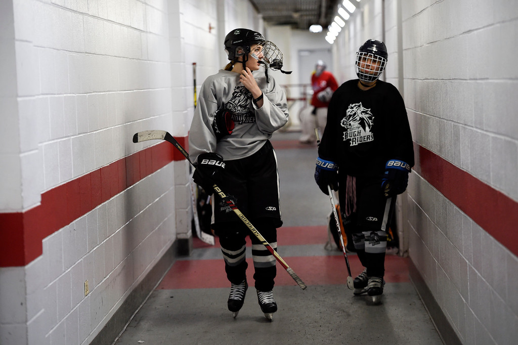 . Girls playing in hockey has become quite popular. Summer Patterson and Jenna Abeyta head down the hall to the ice for practice for the Lady Rough Riders February 21, 2016 at the Ice Center at the Promenade. The growth of hockey in Colorado has gone up  in the last 20 years since The Avalanche came to town. (Photo By John Leyba/The Denver Post)