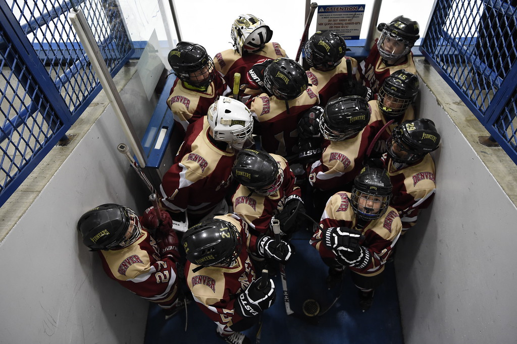 . The DU Pioneers gather at the entrance to the ice getting ready for their game against the Eagles. The Eagles defeated the Pioneers 4-3 to capture the CCYHL Squirt A Governors Championship. February 21, 2016 at the Ice Center at the Promenade. (Photo By John Leyba/The Denver Post)