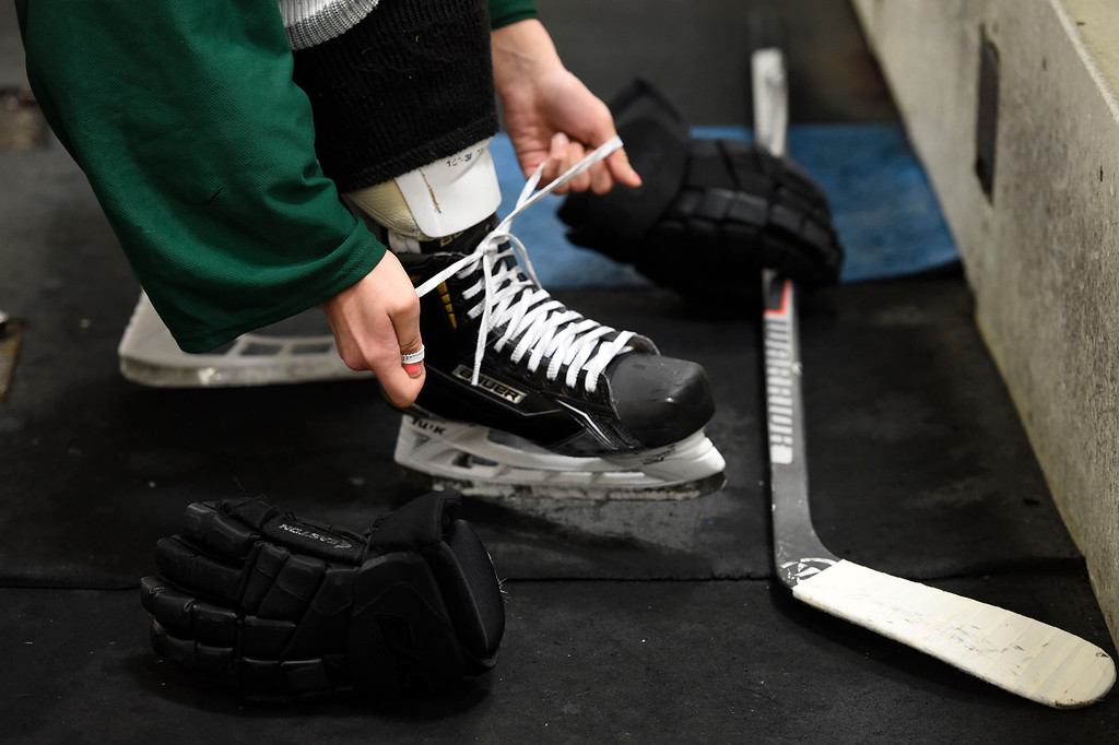 . Girls lacing the skates up as become become quite popular. The  Lady Rough Riders take to the ice for practice February 21, 2016 at the Ice Center at the Promenade. The growth of hockey in Colorado has gone up  in the last 20 years since The Avalanche came to town. (Photo By John Leyba/The Denver Post)