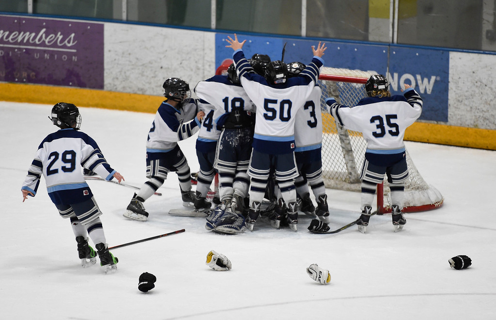 . The Eagles celebrate their win as they defeated the Pioneers 4-3 to capture the CCYHL Squirt A Governors Championship. February 21, 2016 at the Ice Center at the Promenade. The game winner came on a power play at 11:53 of the third period when Carson Forker hit the game winner on a backhand shot.  (Photo By John Leyba/The Denver Post)