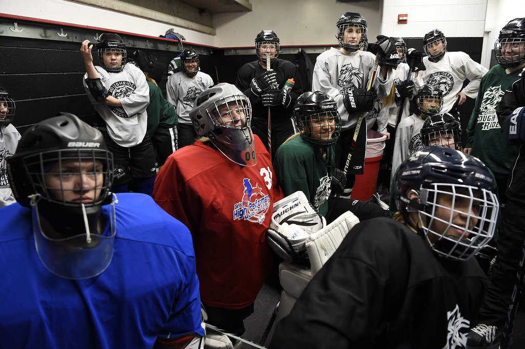 . Girls playing in hockey has become quite popular. The Lady Rough Riders listen to catch Jordan Slavin in the locker room before their practice February 21, 2016 at the Ice Center at the Promenade. The growth of hockey in Colorado has gone up  in the last 20 years since The Avalanche came to town. (Photo By John Leyba/The Denver Post)