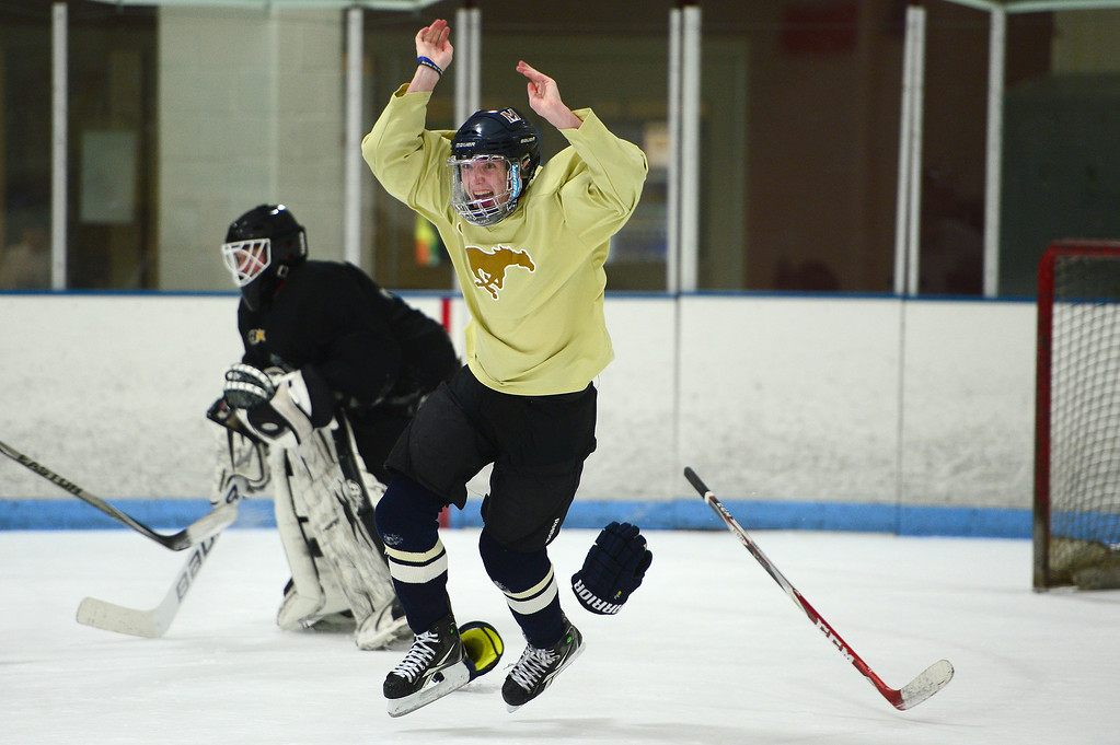 . Mullen High School\'s Eli Mills, celebrates after making the last goal of pratice at Edge Ice Arena on February 17, 2016 in Littleton, Colorado. Hockey has developed a following in Colorado especially after the Colorado Avalanche moved into the state 20 years ago. The interest in hockey has begun to boom from three-year-olds to adults, either playing in recreation leagues or learning the game for the first time. The Foothill Flyers are one of those organizations seeing some of that trend with enrollment in their Under 8 league going from 50 children to 100 in three years. (Photo by Brent Lewis/The Denver Post)