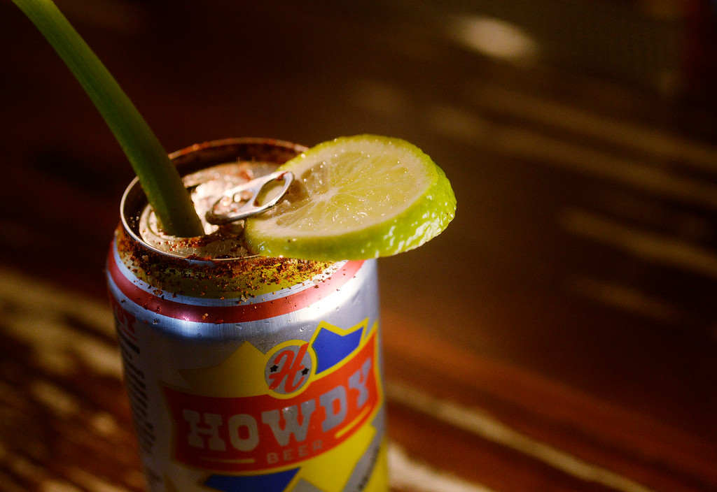 . The  Howdy Michelada with spices on the rim of a Post Brewing Co. can of Howdy Beer at  the GoodBird Kitchen,  a new restaurant in Longmont, CO on  Thursday, February 25, 2016.  (Photo by Cyrus McCrimmon/ The Denver Post)