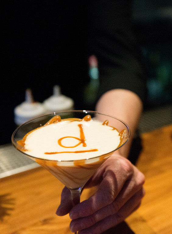 . Bar manager Charles Kollmann makes a salted caramel martini during the happy hour at the D Bar Denver on Friday, February 26, 2016.  (Photo by Cyrus McCrimmon/ The Denver Post)