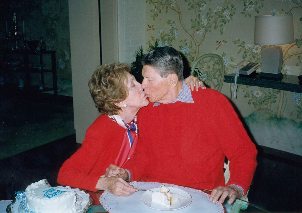 . Former President Ronald Reagan Gets A Kiss From His Wife Nancy On The Occasion Of His 89Th Birthday February 6, 2000 At Their Home In Bel Air, California. Reagan Turned 90 Years-Old February 6, 2001 While At Home Recovering From A Broken Hip.  (Photo By Getty Images)